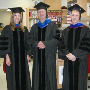 Cox, Cox, Harris in grad gowns