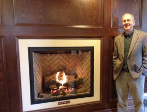 M Cox with fireplace